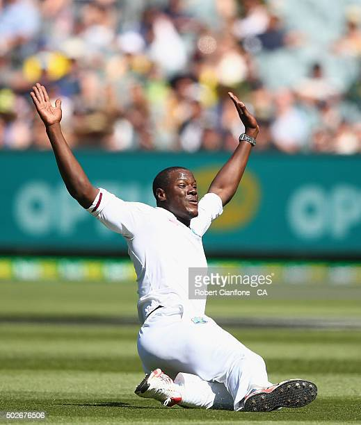 Carlos Brathwaite of the West Indies celebrates after taking the wicket of David Warner of Australia during day three of the Second Test match...