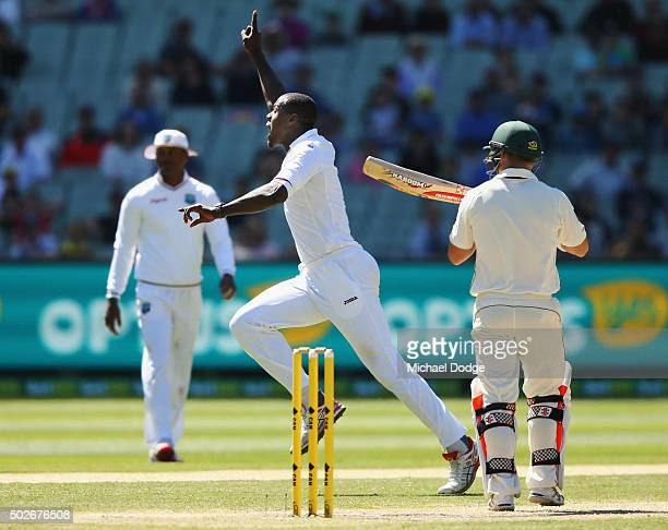 Carlos Brathwaite of the West Indies celebrates his wicket of David Warner of Australia during day three of the Second Test match between Australia...