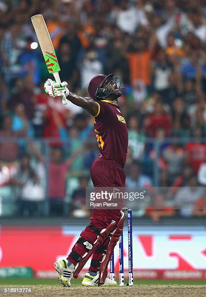 Carlos Brathwaite of the West Indies celebrates hitting the winning runs during the ICC World Twenty20 India 2016 Final match between England and...