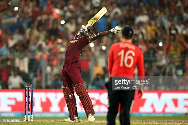 Carlos Brathwaite of the West Indies celebrates the winning runs during the ICC World Twenty20 India 2016 final match between England and West Indies...