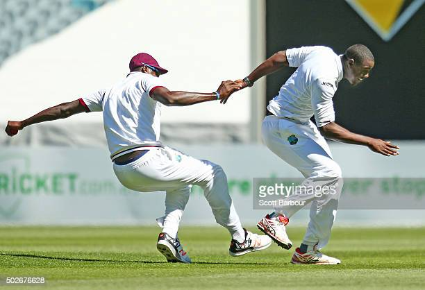 Carlos Brathwaite of the West Indies collides with catcher Jason Holder as he congratulates him after dismissing David Warner of Australia during day...