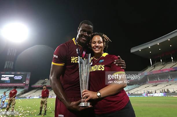 Carlos Brathwaite of the West Indies poses with partner Jessica Felix during the ICC World Twenty20 India 2016 final match between England and West...