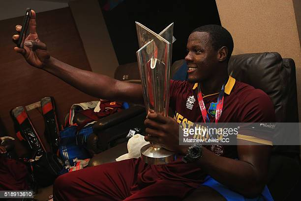 Carlos Brathwaite of the West Indies takes a selfie with the ICC World Twenty20 trophy during the ICC World Twenty20 India 2016 Final between England...