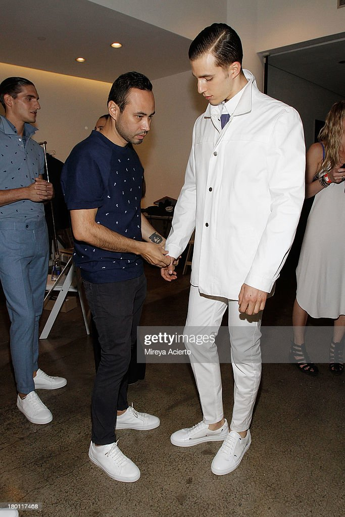Carlos Campos dresses a model at the Carlos Campos presentation during MADE Fashion Week Spring 2014 at Milk Studios on September 8, 2013 in New York City.