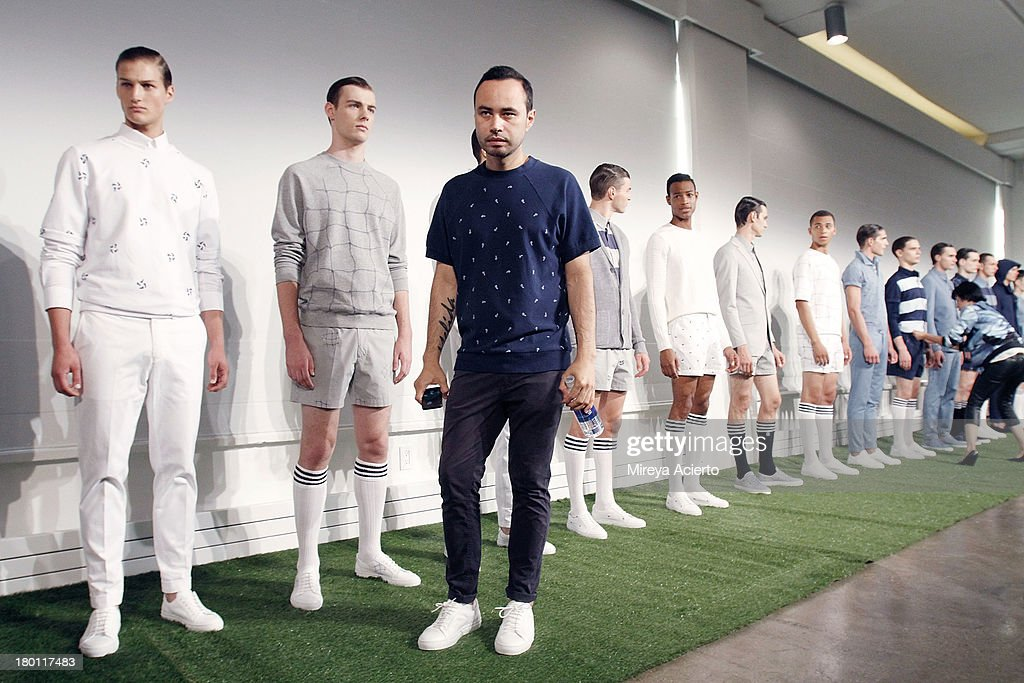 Carlos Campos poses with models at the Carlos Campos presentation during MADE Fashion Week Spring 2014 at Milk Studios on September 8, 2013 in New York City.
