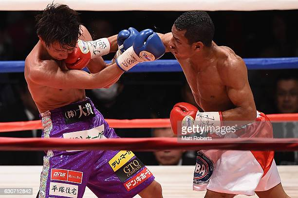Carlos Canizales punches Ryoichi Taguchi during the WBA World Light Flyweight Title bout between Ryoichi Taguchi of Japan and Carlos Canizales of...