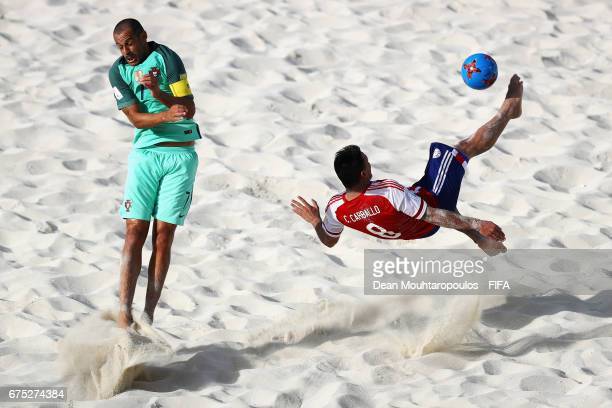 Carlos Carballo of Paraguay attempts a scissor or bicycle kick shot on goal in front of pt7 of Portugal during the FIFA Beach Soccer World Cup...