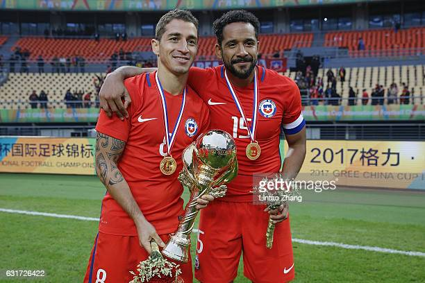 Carlos Carmona and Jean Beausejour of Chile poses with the trophy after winning the final match of 2017 Gree China Cup International Football...