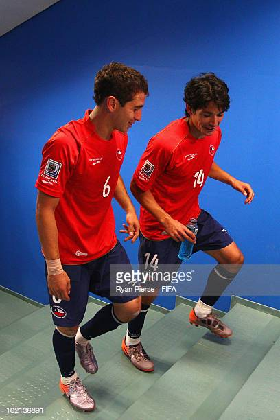 Carlos Carmona and Matias Fernandez of Chile walk up the stairs to their dressing room after the 2010 FIFA World Cup South Africa Group H match...
