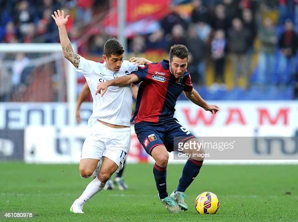 Carlos Carmona of Atalanta BC competes for the ball with Andrea Bertolacci of Genoa CFC during the Serie A match between Genoa CFC and Atalanta BC at...
