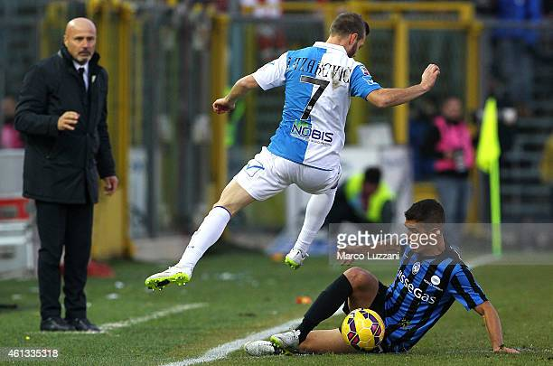 Carlos Carmona of Atalanta BC competes for the ball with Dejan Lazarevic of AC Chievo Verona during the Serie A match between Atalanta BC and AC...