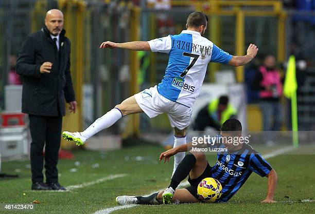 Carlos Carmona of Atalanta BC competes for the ball with Dejan Lazarevic of AC Chievo Verona during the Serire A match between Atalanta BC and AC...