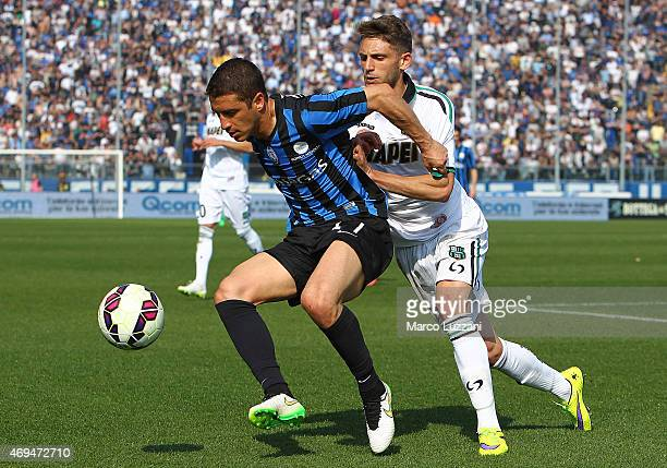 Carlos Carmona of Atalanta BC competes for the ball with Domenico Berardi of US Sassuolo Calcio during the Serie A match between Atalanta BC and US...