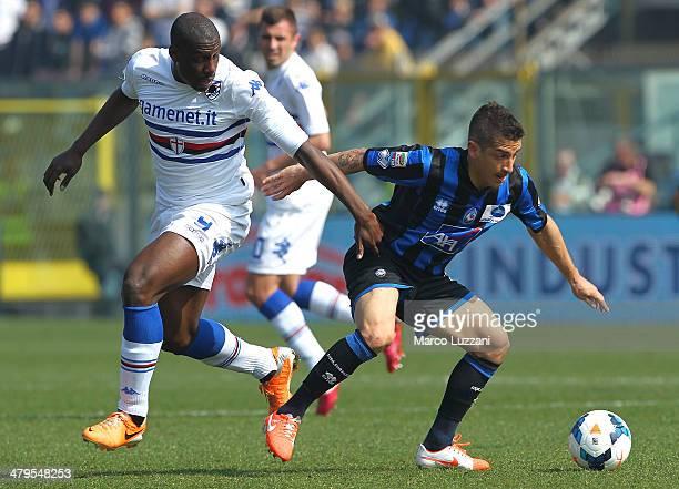 Carlos Carmona of Atalanta BC competes for the ball with Stefano Chuka Okaka of UC Sampdoria during the Serie A match between Atalanta BC and UC...