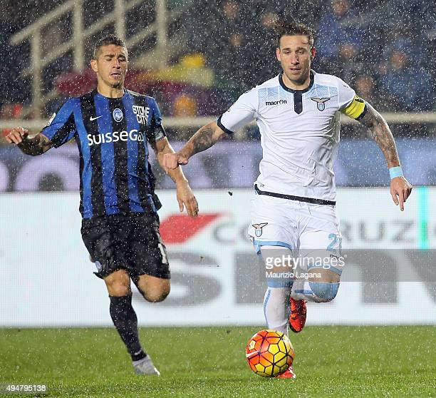 Carlos Carmona of Atalanta competes for the ball with Lucas Biglia of Lazio during the Serie A match between Atalanta BC and SS Lazio at Stadio...