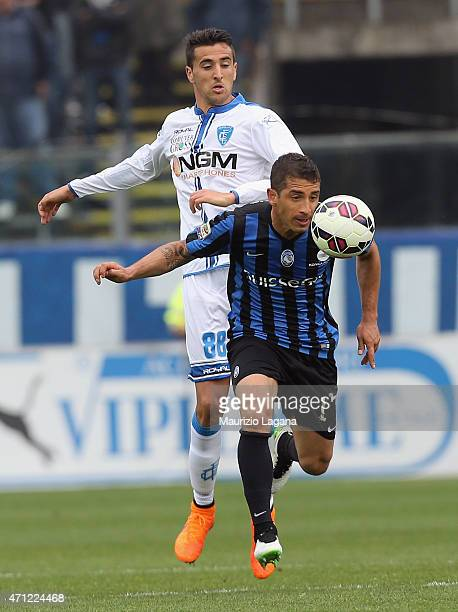 Carlos Carmona of Atalanta competes for the ball with Matias Vecino of Empoli during the Serie A match between Atalanta BC and Empoli FC at Stadio...