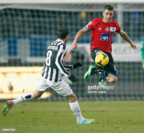 Carlos Carmona of Atalanta is challenged by Claudio Marchisio during the Serie A match between Atalanta BC and Juventus at Stadio Atleti Azzurri...