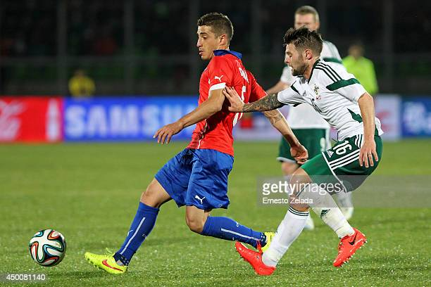 Carlos Carmona of Chile struggles for the ball with Oliver Norwood of Northern Ireland during the international friendly match between Chile and...
