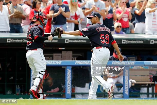 Carlos Carrasco and Roberto Perez of the Cleveland Indians return to the dugout against the New York Yankees in the fifth inning at Progressive Field...