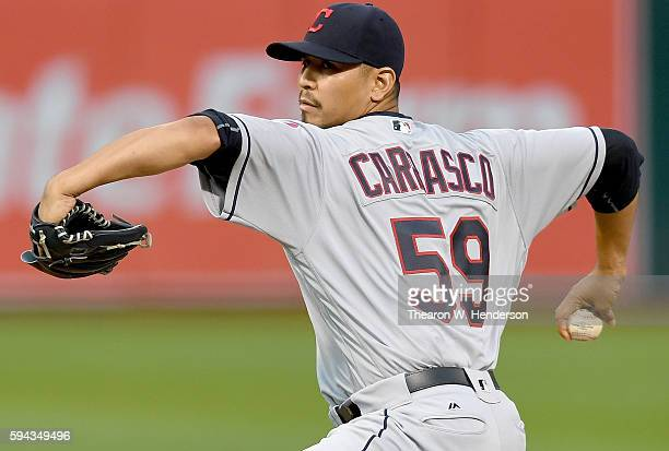 Carlos Carrasco of the Cleveland Indians pitches against the Oakland Athletics in the bottom of the first inning at Oco Coliseum on August 22 2016 in...