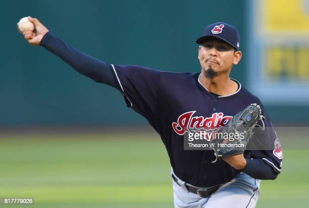 Carlos Carrasco of the Cleveland Indians pitches against the Oakland Athletics in the bottom of the first inning at Oakland Alameda Coliseum on July...