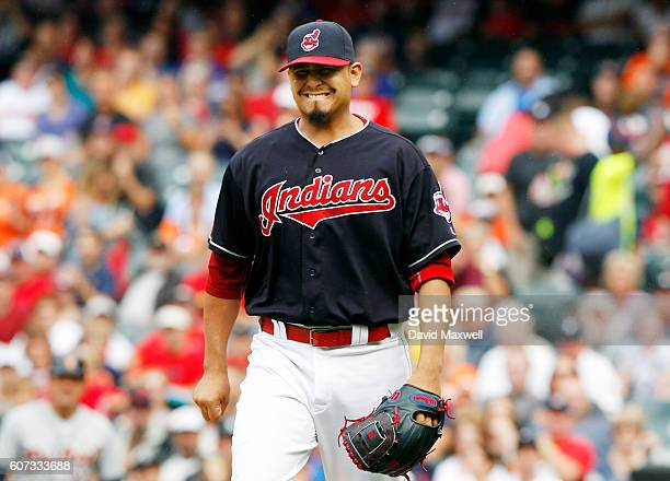 Carlos Carrasco of the Cleveland Indians reacts after being hit by a line drive by Ian Kinsler of the Detroit Tigers in the first inning at...