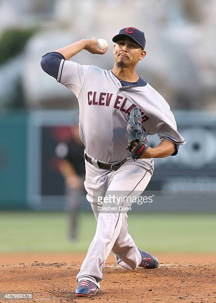 Carlos Carrasco of the Cleveland Indians throws a pitch against the Los Angeles Angels of Anaheim at Angel Stadium of Anaheim on August 4 2015 in...