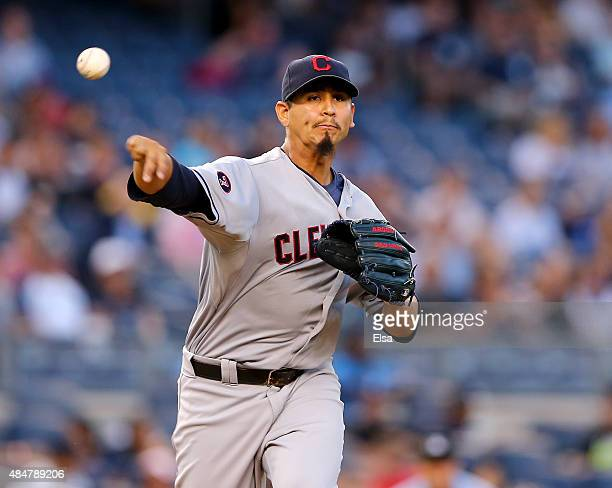 Carlos Carrasco of the Cleveland Indians tries to pick off Brett Gardner of the New York Yankees at first base in the first inning on August 21 2015...