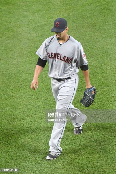 Carlos Carrasco of the Cleveland Indians walks back to the dug out during a baseball game against the Baltimore Orioles at Oriole park at Camden...