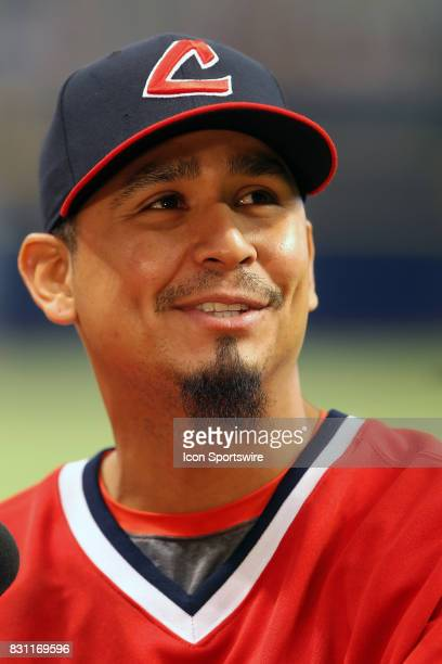 Carlos Carrasco of the Indians looks up into the stands at some fans before the MLB regular season game between the Cleveland Indians and Tampa Bay...