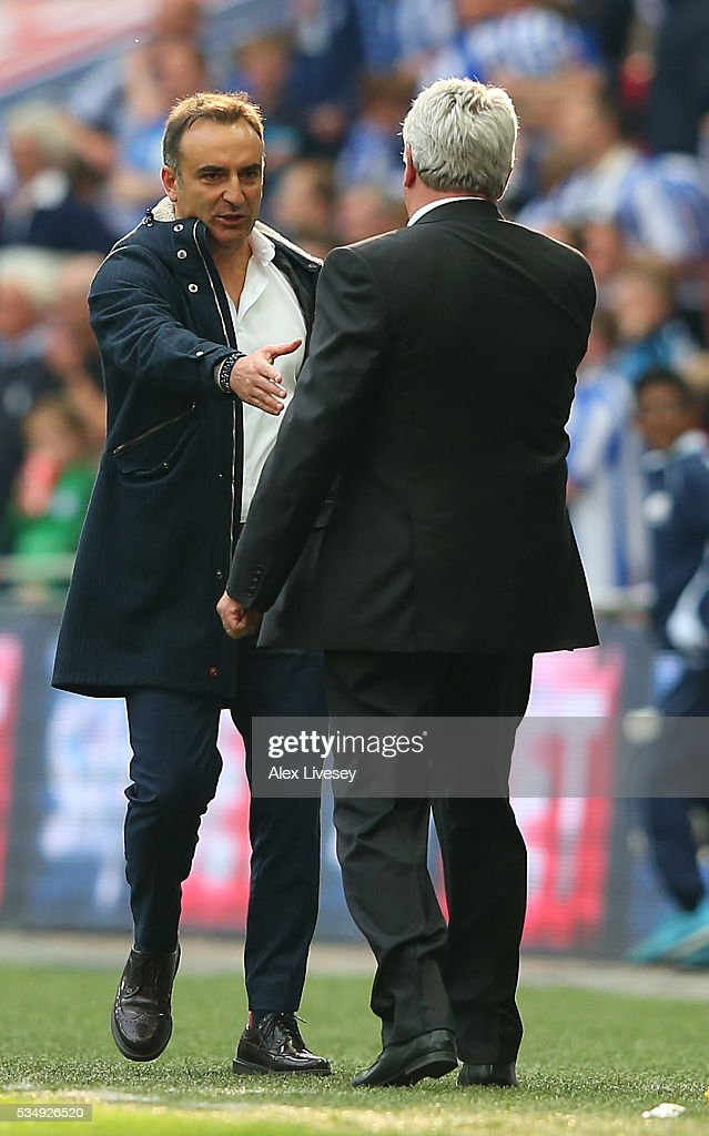 Carlos Carvalhal manager of Sheffield Wednesday congratulates Steve Bruce, manager of Hull City after the Sky Bet Championship Play Off Final match between Hull City and Sheffield Wednesday at Wembley Stadium on May 28, 2016 in London, England.