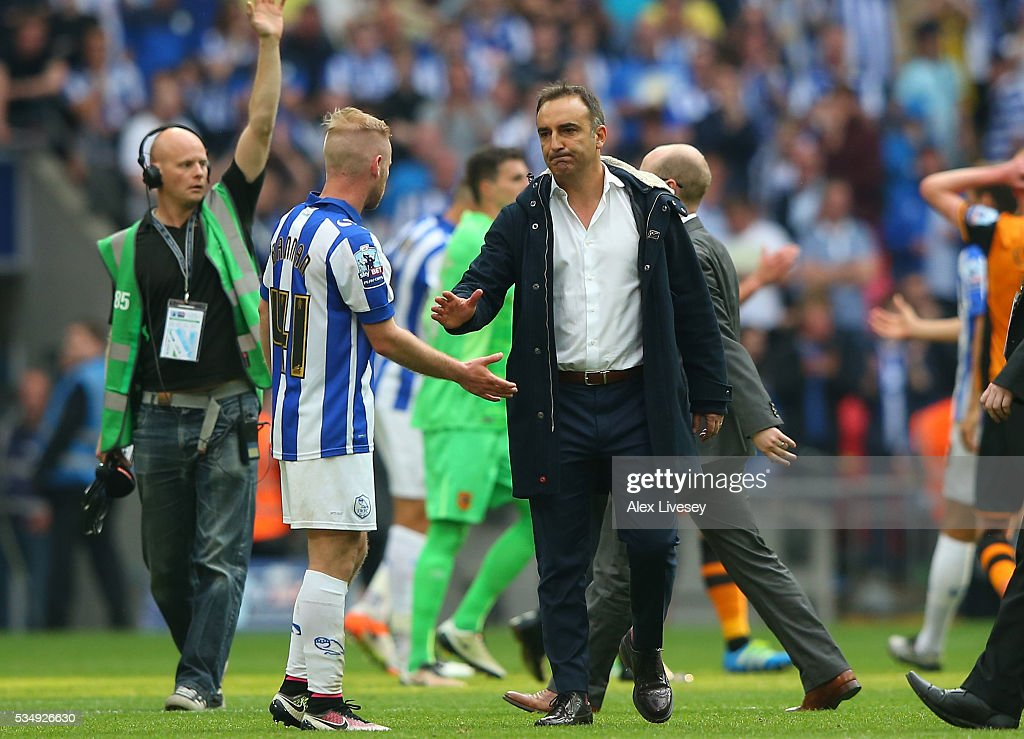 Carlos Carvalhal manager of Sheffield Wednesday consoles his player <a gi-track='captionPersonalityLinkClicked' href=/galleries/search?phrase=Barry+Bannan&family=editorial&specificpeople=5449430 ng-click='$event.stopPropagation()'>Barry Bannan</a> after Sky Bet Championship Play Off Final match between Hull City and Sheffield Wednesday at Wembley Stadium on May 28, 2016 in London, England.