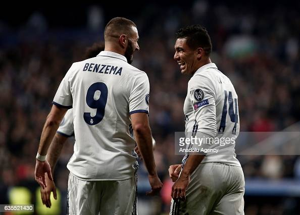 Carlos Casemiro of Real Madrid celebrates scoring a goal with his team mate Karim Benzema during the UEFA Champions League round of 16 match between...