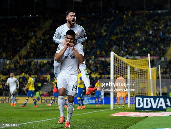 Carlos Casemiro of Real Madrid CF celebrates scoring their second goal with teammate Sergio Ramos during the La Liga match between UD Las Palmas and...