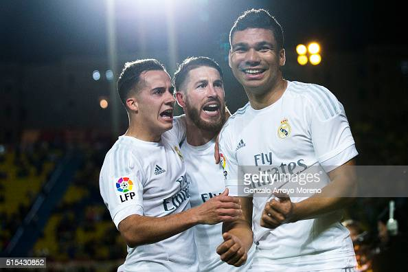 Carlos Casemiro of Real Madrid CF celebrates scoring their second goal with teammates Sergio Ramos and Lucas Vazquez during the La Liga match between...