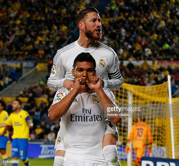Carlos Casemiro of Real Madrid CF celebrates scoring their second goal with Sergio Ramos during the La Liga match between UD Las Palmas and Real...