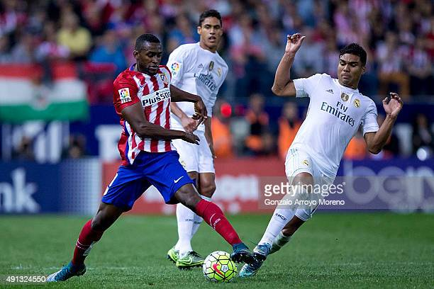 Carlos Casemiro of Real Madrid CF competes for the ball with Jackson Arley Martinez of Atletico de Madrid during the La Liga match between Club...