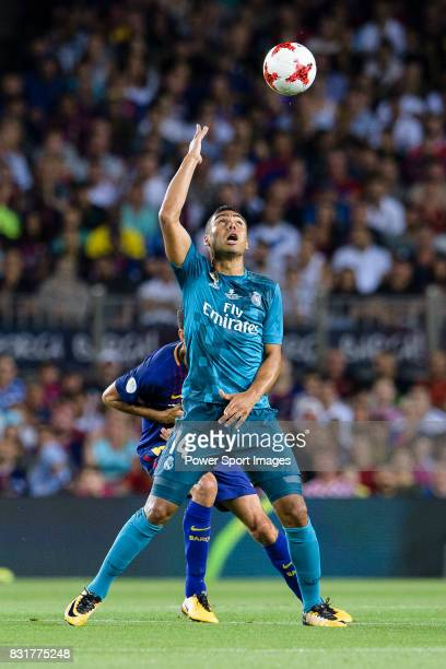 Carlos Casemiro of Real Madrid fights for the ball with Sergio Busquets of FC Barcelona during the Supercopa de Espana Final 1st Leg match between FC...
