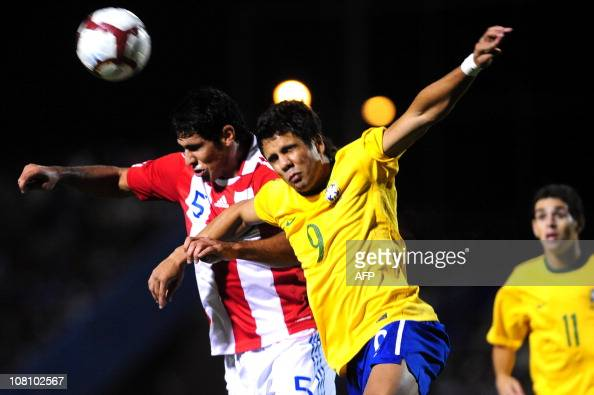 Carlos Casimiro from Brazil vies for the ball with Paraguay's Diego Viera during their South American Under20 football championship match at the...