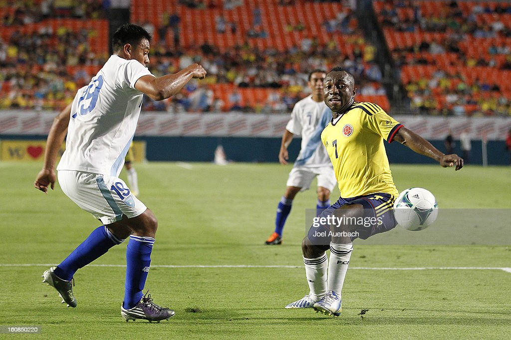Carlos Castrillo #19 of Guatemala and Pablo Armero #7 of Colombia chase a loose ball on February 6, 2013 at SunLife Stadium Stadium in Miami Gardens, Florida. Colombia defeated Guatemala 4-1.