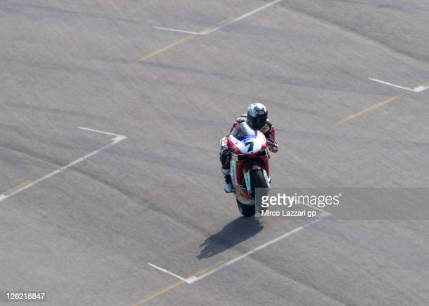 Carlos Checa of Spain and Althea Racing lifts the front wheel during the practice session of Superbike World Championship Round Eleven at Autodromo...