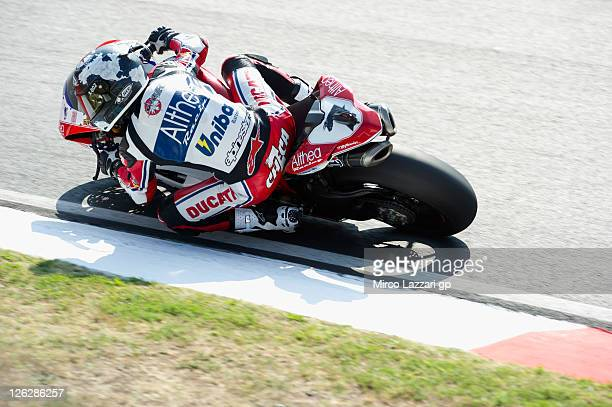 Carlos Checa of Spain and Althea Racing rounds the bend during the qualifying practice of Superbike World Championship Round Eleven at Autodromo Enzo...