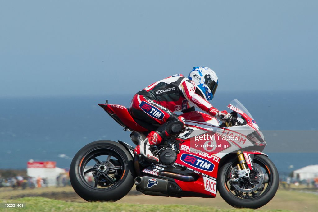 Carlos Checa of Spain and Team Ducati Alstare heads down a straight during qualifying practice ahead of the World Superbikes at Phillip Island Grand Prix Circuit on February 22, 2013 in Phillip Island, Australia.