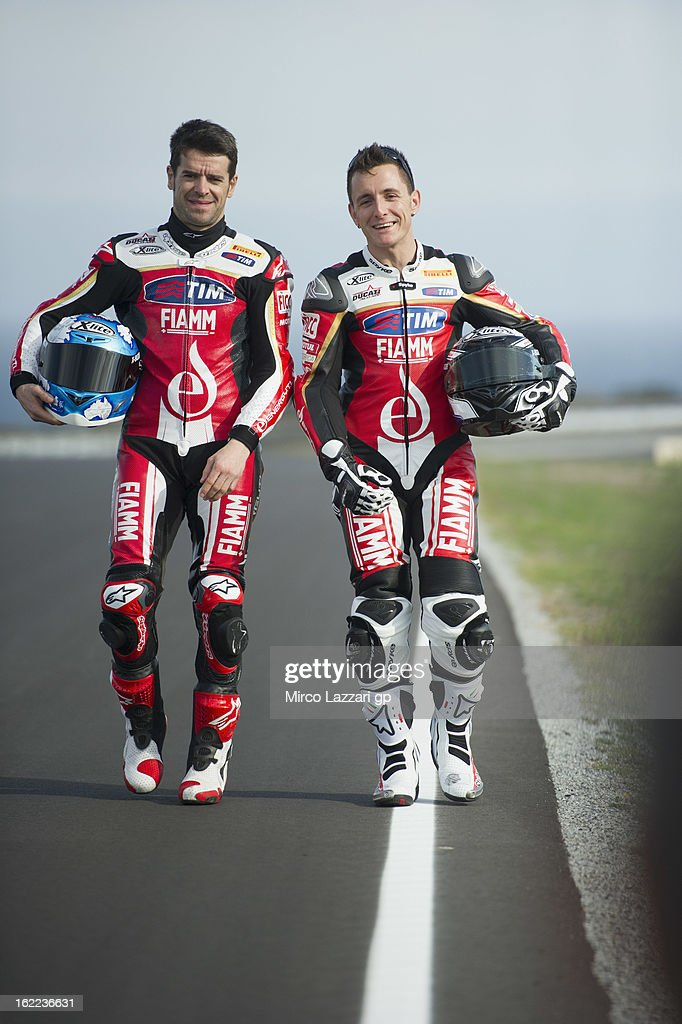 <a gi-track='captionPersonalityLinkClicked' href=/galleries/search?phrase=Carlos+Checa&family=editorial&specificpeople=235726 ng-click='$event.stopPropagation()'>Carlos Checa</a> of Spain and Team Ducati Alstare walks with Ayrton Badovini (R) of Italy and Team Ducati Alstare on track before the ufficial photo during the round first of 2013 Superbike FIM World Championship at Phillip Island Grand Prix Circuit on February 21, 2013 in Phillip Island, Australia.