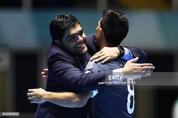 Carlos Chilavert the coach of Paraguayy celebrates with Juan Morel of Paraguay as Paraguay win a penalty shoot out during the FIFA Futsal World Cup...