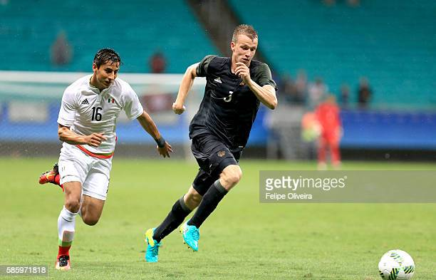 Carlos Cisneros of Mexico is chasing Lukas Klostermann of Germany during the Men's Group C first round match between Mexico and Germany during the...