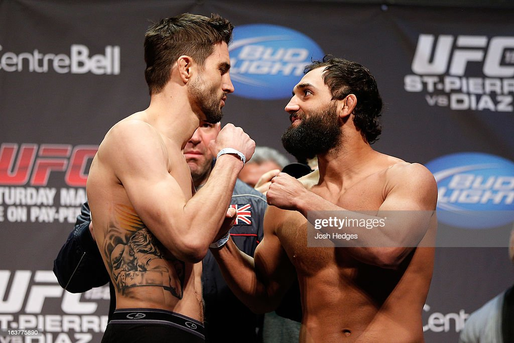 Carlos Condit and Johny Hendricks face off during the UFC 158 weigh-in at Bell Centre on March 15, 2013 in Montreal, Quebec, Canada.