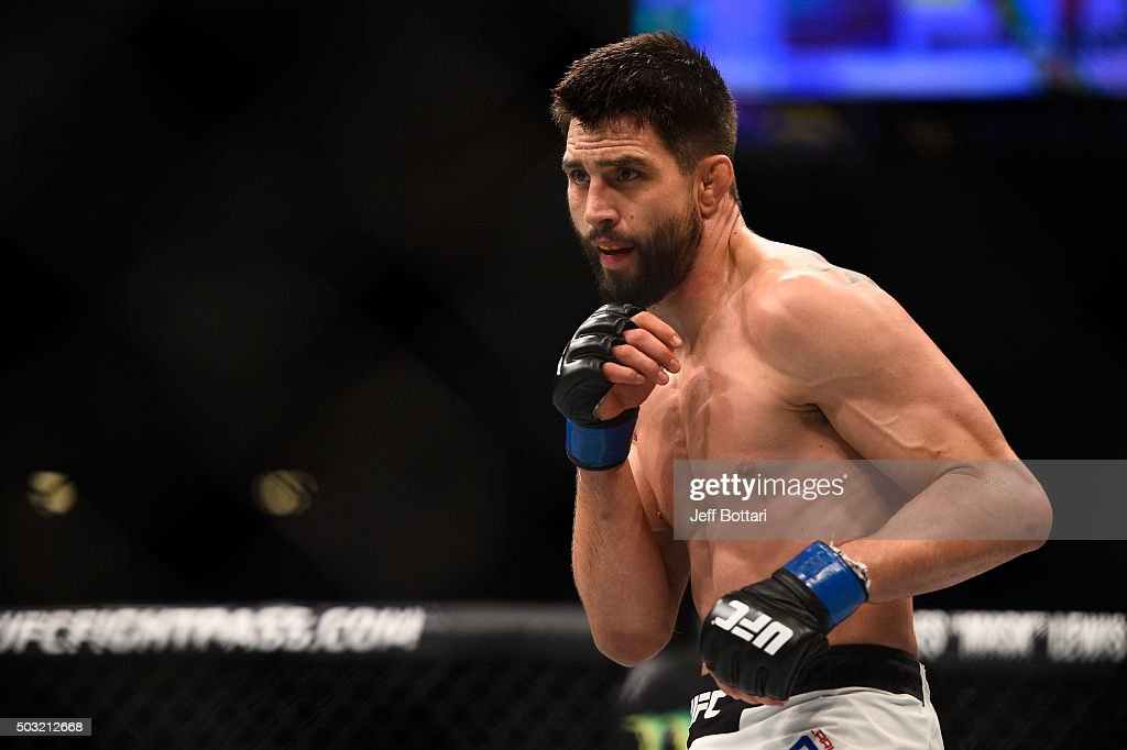 Carlos Condit faces off against his opponent in his UFC welterweight championship bout during the UFC 195 event inside MGM Grand Garden Arena on...