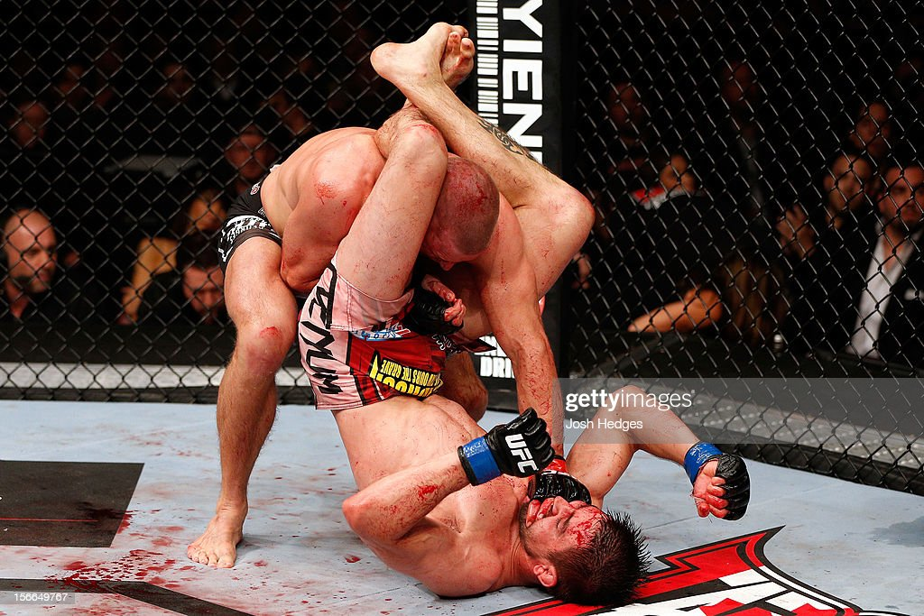 Carlos Condit (R) grapples against Georges St-Pierre in their welterweight title bout during UFC 154 on November 17, 2012 at the Bell Centre in Montreal, Canada.