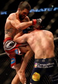 Carlos Condit knees Martin Kampmann in their welterweight fight during the UFC on FOX Sports 1 event at Bankers Life Fieldhouse on August 28 2013 in...